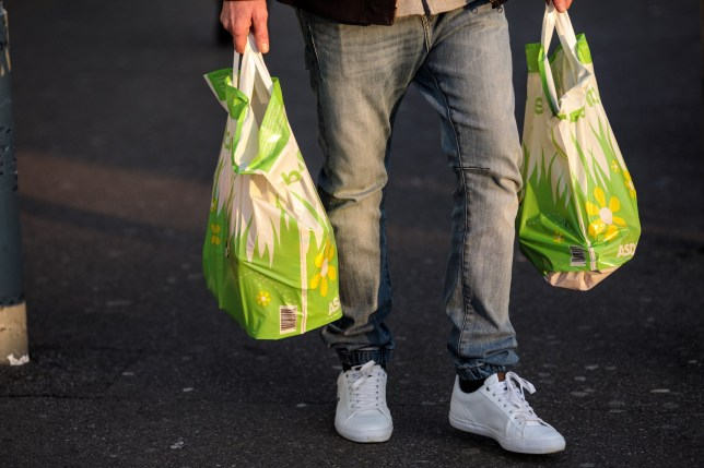 LONDON, ENGLAND - DECEMBER 27: Plastic Asda bags are carried by a shopper on December 27, 2018 in London, England. England???s current 5-pence fee for plastic shopping bags could double in 2020, under plans announced by Environment Secretary Michael Gove. The levy would also apply to smaller retailers currently exempted from the law. (Photo by Jack Taylor/Getty Images)