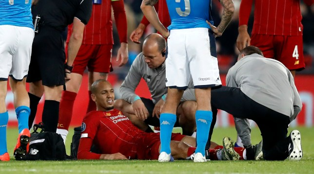 Liverpool's Fabinho receives medical attention during a game