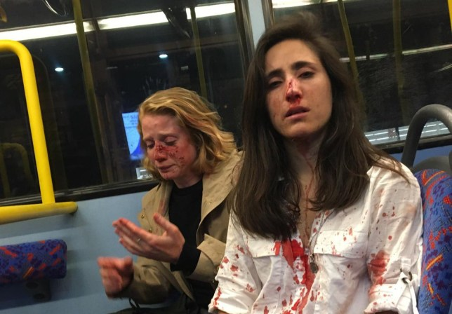 Boys admit attacking woman on bus This horrifying picture shows a flight attendant and her girlfriend covered in blood after a gang of men attacked them when they refused to kiss for them. The apparently homophobic attack happened on a London bus as the couple returned home from an evening out last month. Ryanair worker Melania Geymonat, 28, from Uruguay, was left with a suspected broken nose while girlfriend Chris, from the US, was also beaten up. Melania, who lives in Bishop?s Stortford, Hertfordshire, said they were sat at the front on the top deck because they enjoyed the novelty of the double decker bus. However, during the journey she claims a gang of young men behind them saw they were a couple and started to demand they kiss while making crude sexual gestures. Picture: Sam Webb