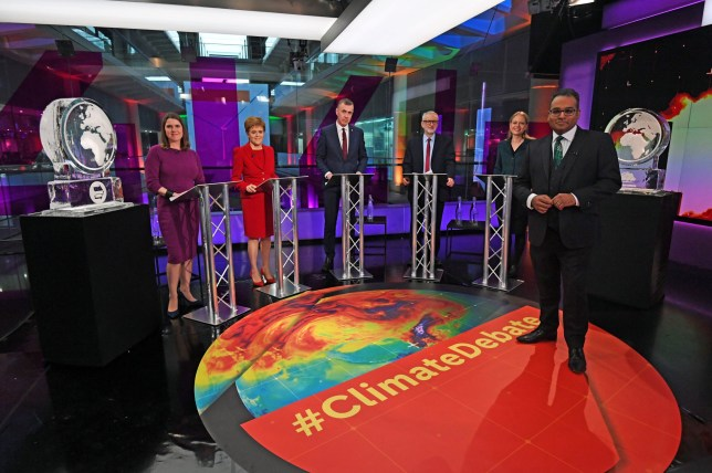 Krishnan Guru-Murthy, Liberal Democrat leader Jo Swinson, SNP leader Nicola Sturgeon, Plaid Cymru leader Adam Price, Labour Party leader Jeremy Corbyn and Green Party Co-Leader Sian Berry, stand next to ice sculptures representing the Brexit Party and Conservative Party who didn't appear at the event, before the start of the Channel 4 News' General Election climate debate at ITN Studios in Holborn, central London, Britain November 28, 2019. Kirsty O'Connor/Pool via REUTERS