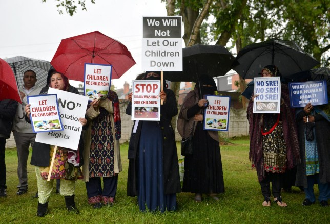 Protestors hold their first demonstration since an injunction was granted barring action immediately outside Anderton Park Primary School, in Moseley, Birmingham, over LGBT relationship education materials being used at the school.