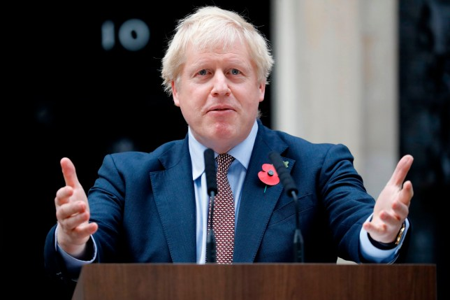 TOPSHOT - Britain's Prime Minister Boris Johnson speaks outside number 10 Downing Street in central London on November 6, 2019. - The splintered country is entering its third general election in four years in search of a solution to a monumental crisis launched by the voters' decision in 2016 to file for a divorce from the European Union after nearly 50 years. (Photo by Tolga AKMEN / AFP) (Photo by TOLGA AKMEN/AFP via Getty Images)