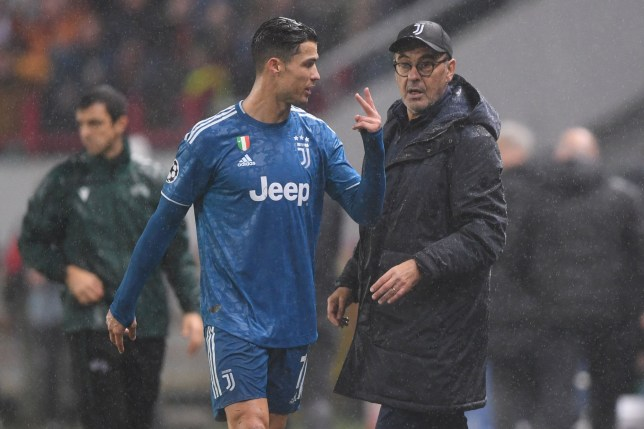Juventus' Portuguese forward Cristiano Ronaldo and Juventus' Italian coach Maurizio Sarri during the UEFA Champions League group D football match between FC Lokomotiv Moscow and Juventus