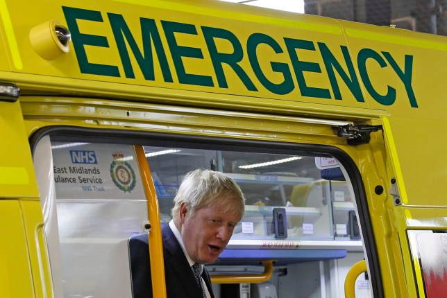 Prime Minister Boris Johnson inspects an ambulance during a visit to Pilgrim Hospital in Boston, Lincolnshire, to announce the government's NHS spending pledge of 1.8 billion.