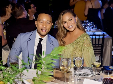 Chrissy Teigen takes thigh-high split to the next level as she's honoured with charity award