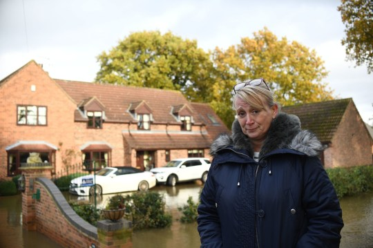 Resident Pam Webb outside Truffle Lodge, her home in Fishlake, Doncaster as parts of England endured a month's worth of rain in 24 hours, with scores of people rescued or forced to evacuate their homes. PA Photo. Picture date: Monday November 11, 2019. See PA story WEATHER Rain. Photo credit should read: Joe Giddens/PA Wire