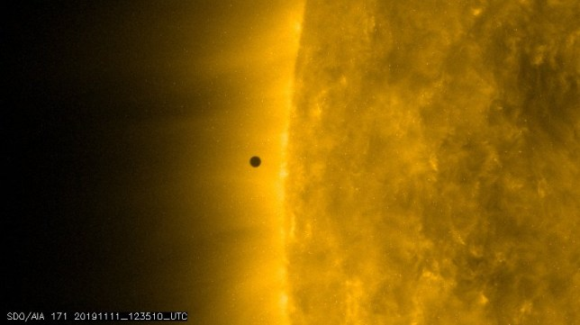 Handout out photo issued by Nasa/SDO of Mercury as it makes a rare transit of the sun on Monday. The smallest planet in the solar system could be seen as a tiny black disc moving across the glowing orb, starting just after 12.35pm. However, poor weather conditions in parts the UK made it hard for some astronomers to see the event. PA Photo. Picture date: Monday November 11, 2019. See PA story SCIENCE Mercury. Photo credit should read: Nasa/SDO/PA Wire NOTE TO EDITORS: This handout photo may only be used in for editorial reporting purposes for the contemporaneous illustration of events, things or the people in the image or facts mentioned in the caption. Reuse of the picture may require further permission from the copyright holder.