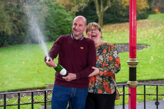 Pictured: David and Lynne Price with celebrate with champagne after they won one million pounds at Bedwellty House,Tredegar, Blaenau Gwent, Wales, UK. Tuesday 12 November 2019 Re: David Price and wife Lynne from New Tredegar are the latest winners from Wales to join the Millionaire club just a week before The National Lottery marks 25 years since its first draw. Lynne, found out that they had won, ten minutes after she was told that had beaten breast cancer. David, 53, who loves the great outdoors, will use part of his windfall to put towards a dream trip to Mount Everest Base Camp next year.