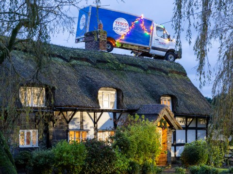 Tesco delivery van used as Christmas decoration on top of thatched cottage