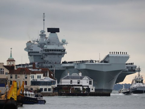 Britain's new £3,100,000,000 aircraft carrier HMS Prince of Wales docks for first time