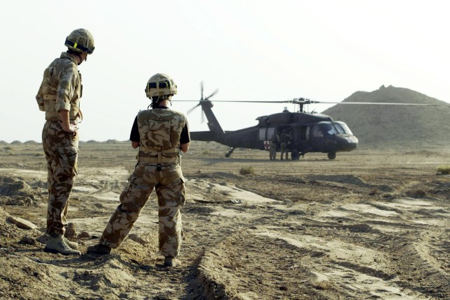 "OVERSEAS USE ONLY: Soldiers from the Black Watch Battle group look on as a USAF Black Hawk Medivac helicopter takes off with a casualty. A Black Watch soldier was injured today in a mortar attack on the Camp Dogwood base, the Ministry of Defence confirmed today. The MoD said the injuries were not thought to be life-threatening. ""A mortar landed inside the compound earlier today, injuring a soldier,"" said a spokesman. ""We do not believe the soldier has life-threatening injuries."""