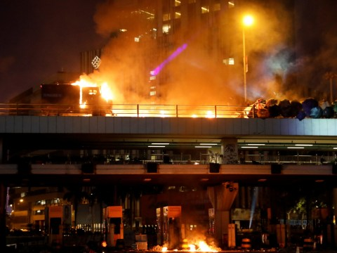 Hong Kong police threaten to fire bullets at protesters as standoff escalates