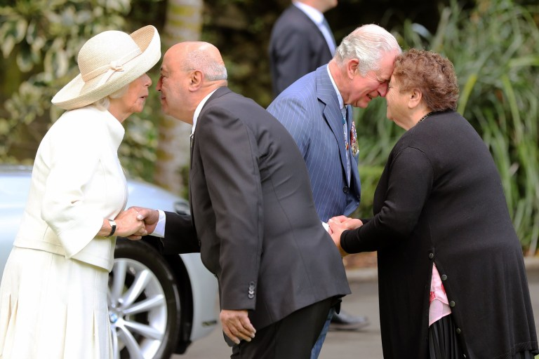 Britain Prince Charles and Camilla, Duchess of Cornwall receive a traditional Maori welcome aduring a welcome ceremony at Government House in Auckland on November 19, 2019. - The Prince of Wales and Duchess of Cornwall are on an 8-day tour of New Zealand. (Photo by MICHAEL BRADLEY / AFP) (Photo by MICHAEL BRADLEY/AFP via Getty Images)