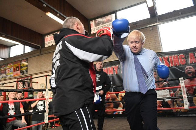 Prime Minister Boris Johnson during a visit to Jimmy Egan's Boxing Academy at Wythenshawe, while on the campaign trail ahead of the General Election. PA Photo. Picture date: Tuesday November 19, 2019. See PA story POLITICS Election. Photo credit should read: Stefan Rousseau/PA Wire