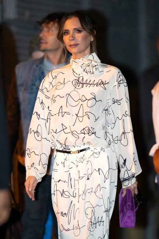 Victoria Beckham cracks ever so slight a smile as she talks about David's 'bronze bottom'