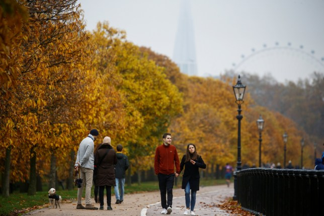 People walk through Hyde Park during autumnal weather in London, Britain, November 23, 2019. REUTERS/Henry Nicholls