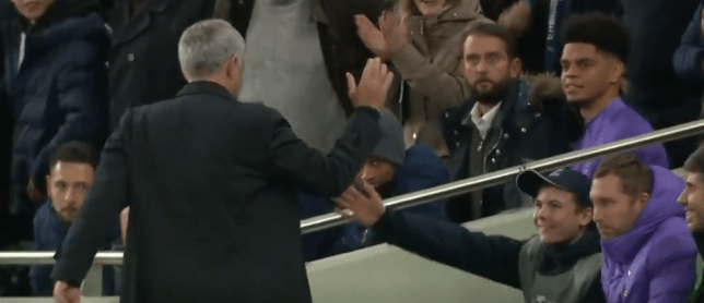 Jose Mourinho high fives a ball boy during Tottenham Hotspur's 4-2 Champions League win against Olympiacos
