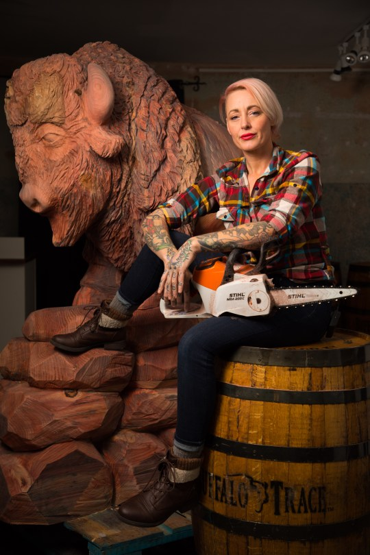 Griffon Ramsey with two-meter bull sculpture at exhibition sponsored by bourbon whiskey brand Buffalo Trace