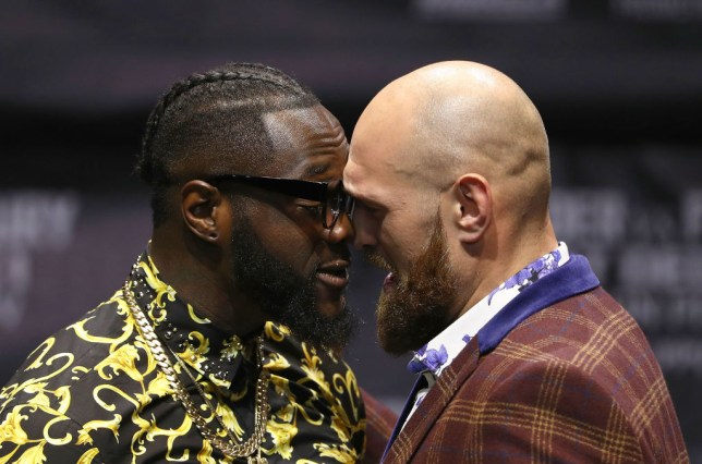 Heavyweight Deontay Wilder touches his head against Tyson Fury in a face-off