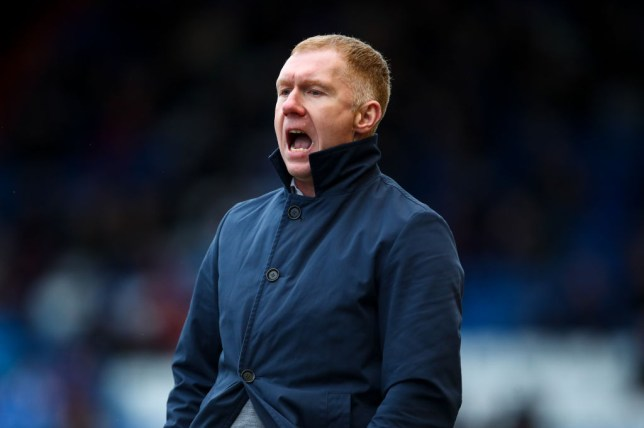Manchester United legend Paul Scholes shouts instructions from the sidelines
