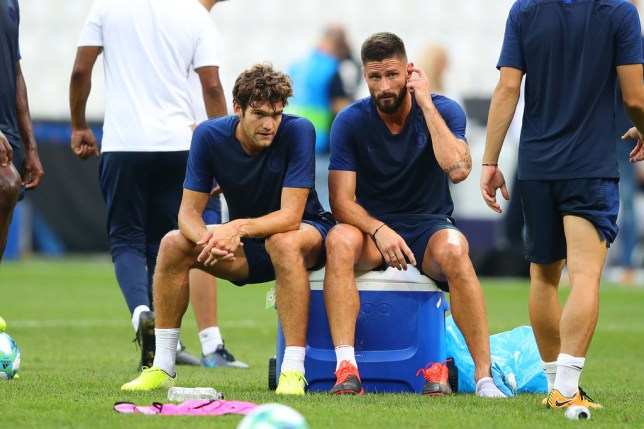 Marcos Alonso and Olivier Giroud speak while taking a break during Chelsea training