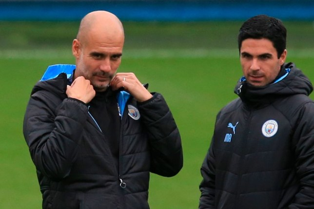 Manchester City boss Pep Guardiola stands alongside assistant and Arsenal target Mikel Arteta