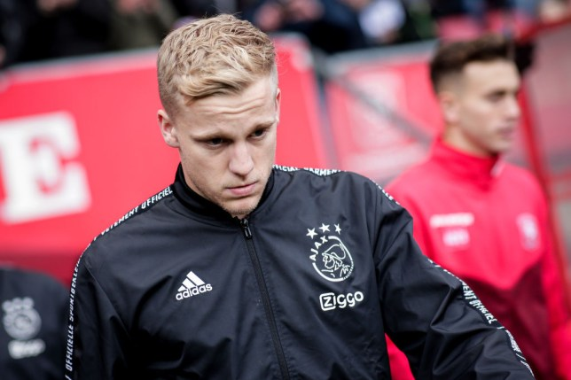 Donny van de Beek is pictured with his head down as he walks onto the pitch before a game for Ajax