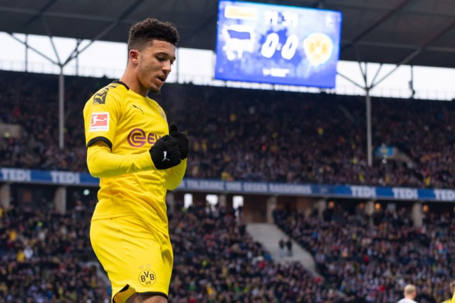 Jadon Sancho punches the air as he celebrates a goal for Borussia Dortmund