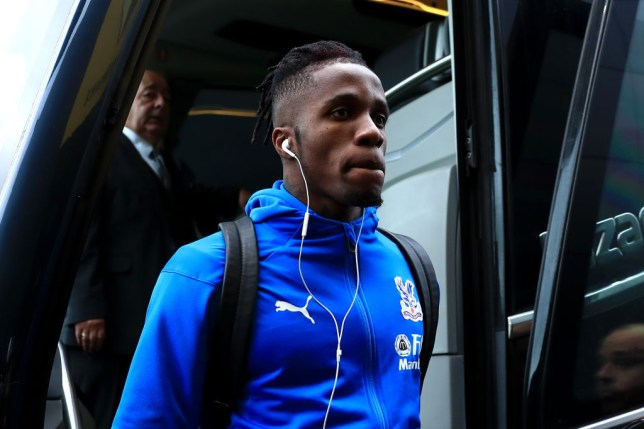 Wilfried Zaha exits the team bus ahead of a Crystal Palace game