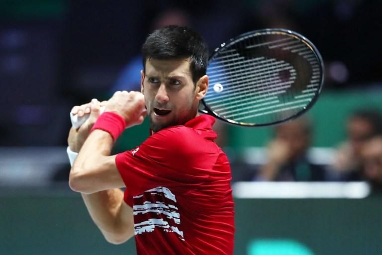 Novak Djokovic hits a backhand