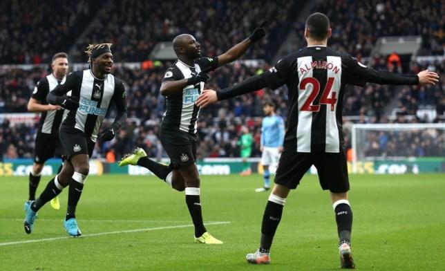 Jetro Willems of Newcastle United celebrates with teammates