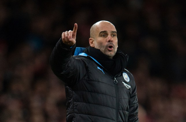 Manchester City manager Pep Guardiola gives instructions to his players