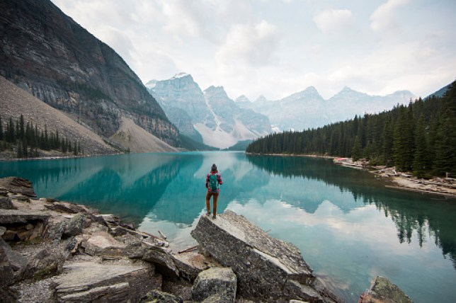 Hiker overlooking Moraine Lake in Canada