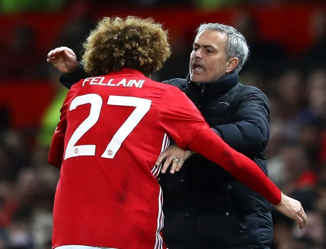 Marouane Fellaini and Jose Mourinho hug during their time at Manchester United
