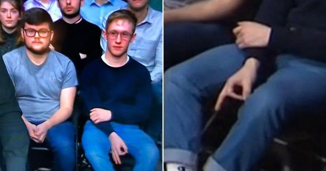 A Question Time audience member makes a hand gesture live on BBC