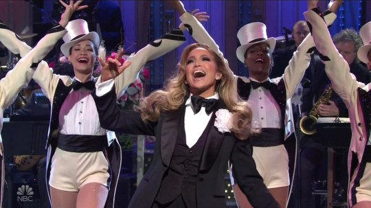 Jennifer Lopez strips off tux to reveal that iconic Versace dress in killer SNL opening monologue