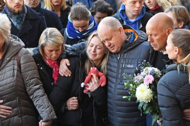 Leanne O'Brien, the girlfriend of Jack Merritt, is comforted by family members during a vigil at The Guildhall in Cambridge to honour both him and Saskia Jones after the two of them were killed in Friday's London Bridge terror attack. PA Photo. Picture date: Monday December 2, 2019. The two were at a conference celebrating the five-year anniversary of the Learning Together prison programme when Usman Khan attacked them and three others. See PA story POLICE LondonBridge. Photo credit should read: Joe Giddens/PA Wire