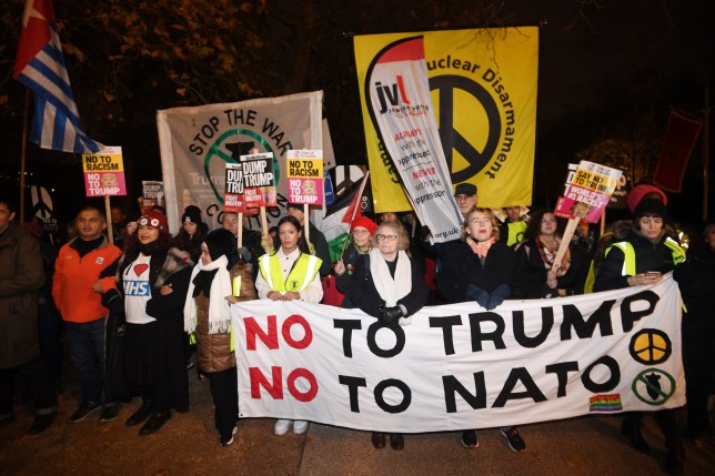 epa08042040 Protesters against the visit of US President Trump during a demonstration near Buckingham Palace on the first day of the NATO Summit in London, Britain, 03 December 2019. NATO countries' heads of states and governments gather in London for a two-day meeting. EPA/FACUNDO ARRIZABALAGA *** Local Caption *** 54486492