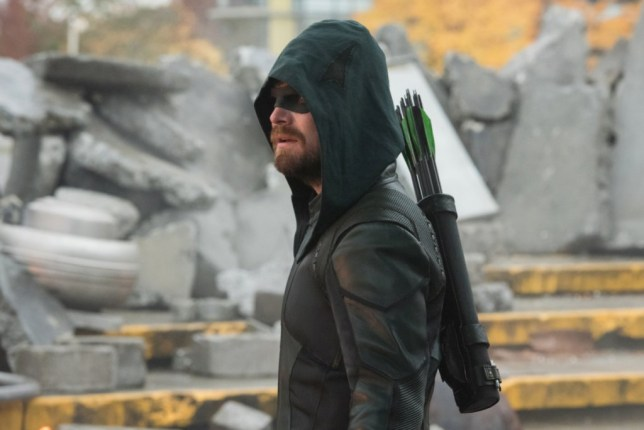 "Supergirl -- ""Crisis on Infinite Earths: Part One"" -- Image Number: SPG509c_0046r.jpg -- Pictured: Stephen Amell as Oliver Queen/Green Arrow -- Photo: Dean Buscher/The CW -- ? 2019 The CW Network, LLC. All Rights Reserved."