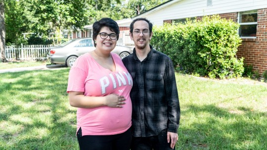 Tory, 20, and her fiancee Travis, 23, outside their home in Jacksonville, FL.