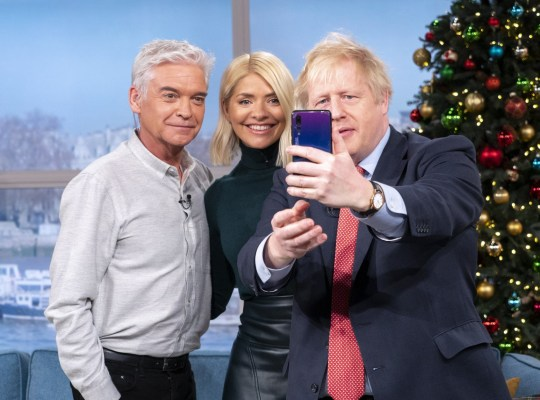 Editorial use only Mandatory Credit: Photo by Ken McKay/ITV/REX/Shutterstock (10492311z) Phillip Schofield and Holly Willoughby with Boris Johnson 'This Morning' TV show, London, UK - 05 Dec 2019 DAYTIME EXCLUSIVE: PRIME MINISTER BORIS JOHNSON In just seven days, the nation will go to the polls in what many have labelled the most vital general election of our generation. But who will hold the keys to Number 10 by the end of next week? Well one man who?s hoping to stay put this Christmas, is Prime Minister Boris Johnson. In a Daytime exclusive, the Prime Minister joins us on the sofa today. We?ll be asking if he is planning to sell our NHS to Donald Trump, whether he really believes Brexit will be done by the end of January, and if he thinks he?ll still have a job in a week?s time.