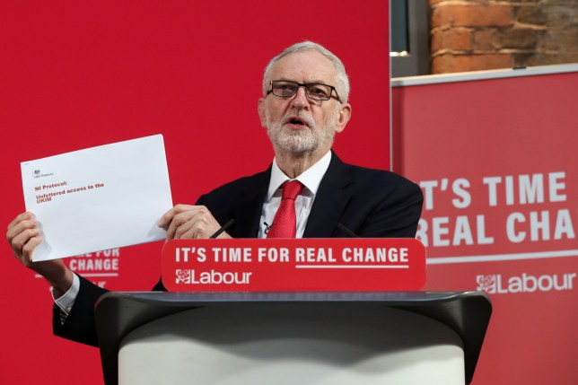 Jeremy Corbyn holds up a document on Brexit at a news conference in London