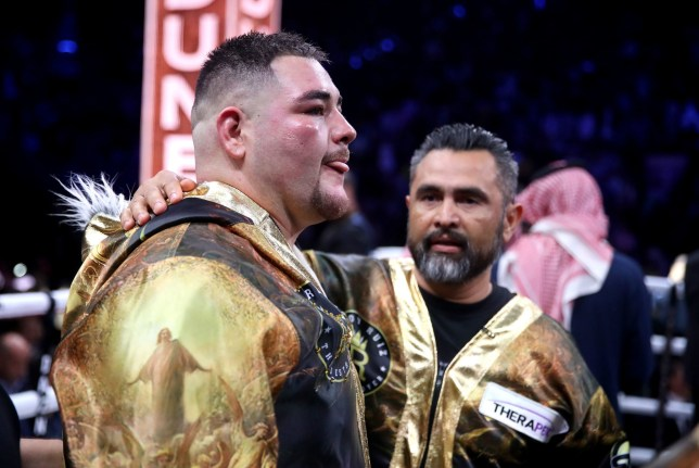 Andy Ruiz is consoled by his trainer after his defeat against Anthony Joshua in their heavyweight rematch