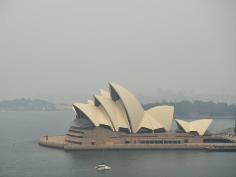 Sydney Opera House is barely visible as wildfires create thick smog