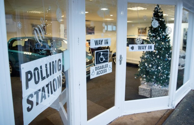 A Christmas tree stands in the window of Petersfield Used Car Centre in Hampshire, which is being used as a polling station in the General Election. PRESS ASSOCIATION Photo. Picture date: Thursday December 12, 2019. See PA story POLITICS . Photo credit should read: Andrew Matthews/PA Wire