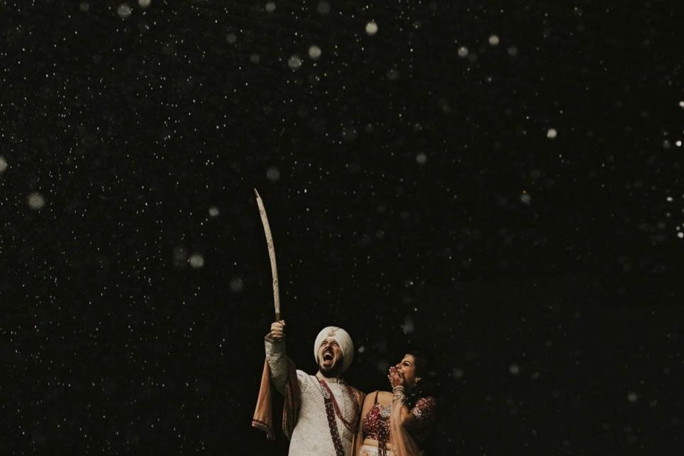 Indian couple among night sky on their wedding day