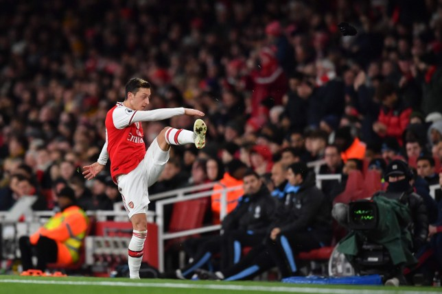 Arsenal's German midfielder Mesut Ozil reacts to his substitution by kicking his gloves along the touchline during the English Premier League football match between Arsenal and Manchester City at the Emirates Stadium in London on December 15, 2019. (Photo by Ben STANSALL / AFP) / RESTRICTED TO EDITORIAL USE. No use with unauthorized audio, video, data, fixture lists, club/league logos or 'live' services. Online in-match use limited to 120 images. An additional 40 images may be used in extra time. No video emulation. Social media in-match use limited to 120 images. An additional 40 images may be used in extra time. No use in betting publications, games or single club/league/player publications. / (Photo by BEN STANSALL/AFP via Getty Images)