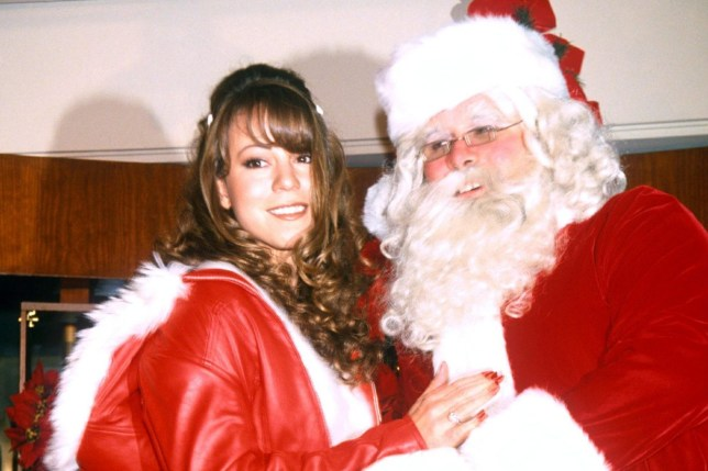 mariah carey posing with santa claus