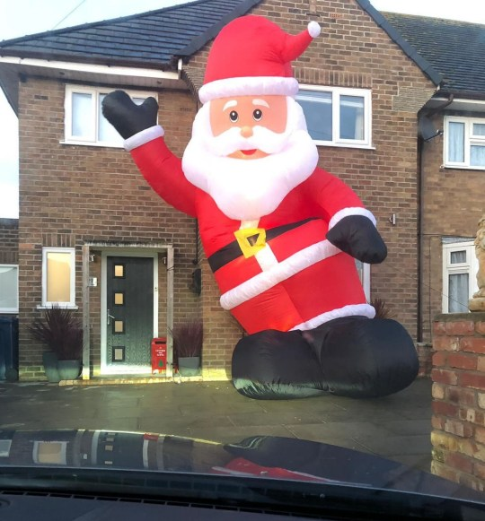 PIC FROM Kennedy News and Media (PICTURED: THE 25FT INFLATABLE SANTA MATTY JAMES ACCIDENTALLY BOUGHT ONLINE) A dad left his neighbours in hysterics after ordering an '8ft' inflatable Santa - only for it to turn out to be a 25ft festive whopper that towers over his house. Matty James bought the ??100 blow-up decoration on eBay to spruce up the outside of his home in Southport, Merseyside, for Christmas. But nightclub owner Matty, 32, was left open-mouthed when the flaccid St Nick was blown up earlier this month [December 6th] and blossomed into a towering 25ft tall accessory that blocked his living room and bedroom windows. DISCLAIMER: While Kennedy News and Media uses its best endeavours to establish the copyright and authenticity of all pictures supplied, it accepts no liability for any damage, loss or legal action caused by the use of images supplied and the publication of images is solely at your discretion. SEE KENNEDY NEWS COPY - 0161 697 4266