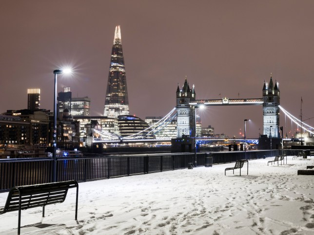 UK, London, snow covered riverbank with view of Tower Bridge, City Hall and the Shard